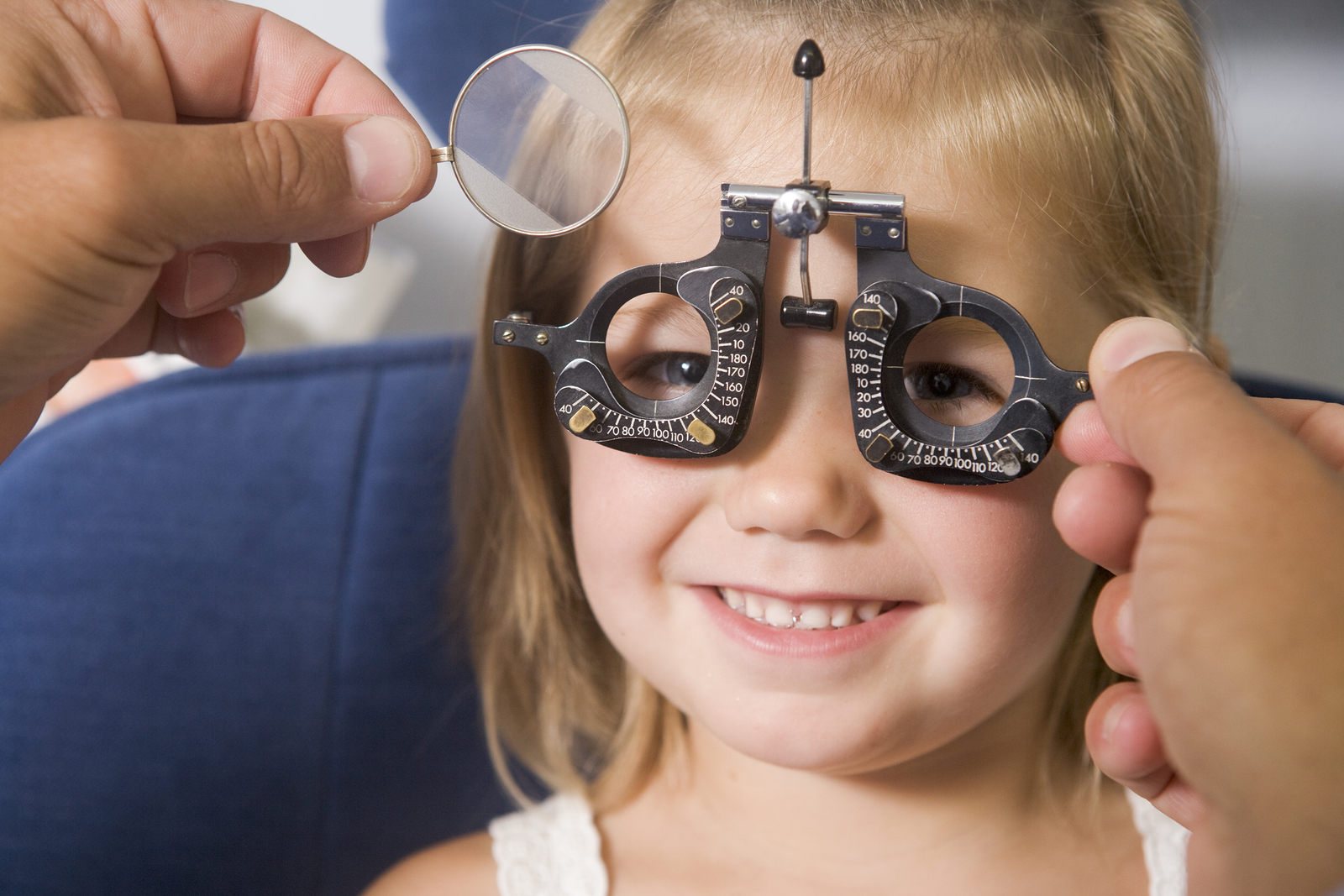 child getting eye examined